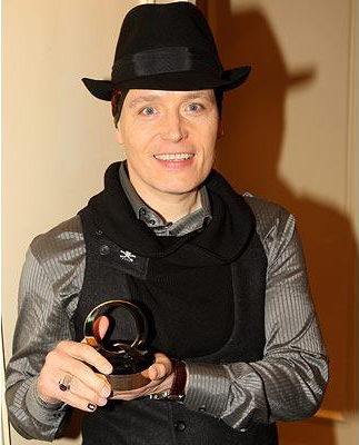 The 80s wallpaper probably with a fedora and a boater called Adam Ant with his Q Icon award 2008