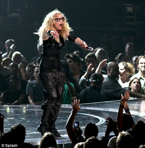 Madona Touring With Geeky Glasses