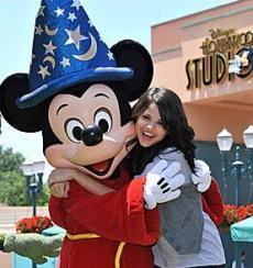 mileys freind (enemy) hugging mickey mouse