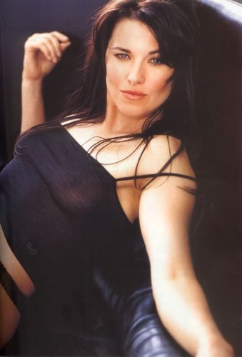 Lucy Lawless wallpaper possibly with attractiveness, a hip boot, and a bustier entitled Maxime
