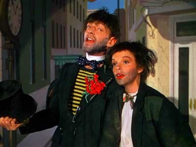 Which film contains a musical number where fred Astaire and Judy Garland are dressed as hoboes?