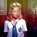 The Parent Trap (1961):  Before going to Camp Inch and trading places with her sister, where did Sharon McKendrick live?