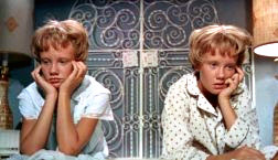 Which actress played the twins in the 1961 version of The Parent Trap?