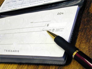 True or False: The first set of company checks printed by the bank spelled our company name wrong.