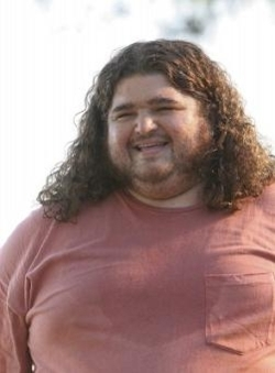 When Hurley stepped on an urchin in the ocean, who did he ask to urinate on his foot to alleviate the pain?
