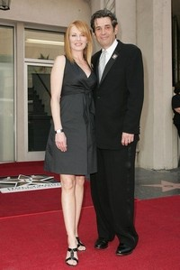 True or False: Marg Helgenberger is married to Alan Rosenberg, who plays a cutthroat prosecutor who has a history with Catherine on the show.