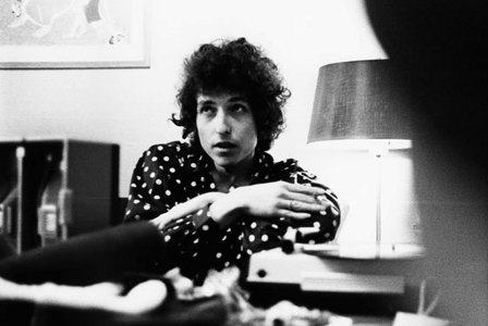 Which Beatles song led Bob Dylan to believe the Beatles already smoked pot inadvertently leading him to turn them on to marijuana?