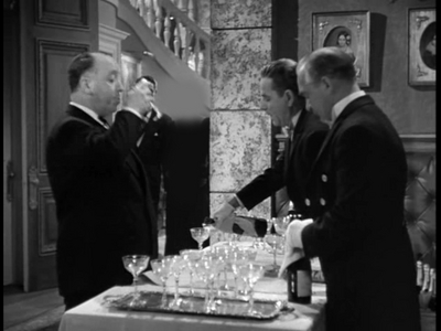 HITCHCOCK CAMEO: In which film is Hitchcock seen sipping champagne at a party?