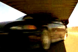 Which member of the Toretto team kept driving their car under the trucks?