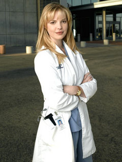 At the end of Season 3, who does Izzie Stevens tell she loves?