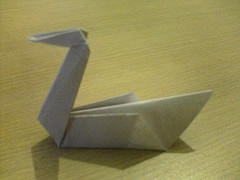 What is the stated meaning of the paper crane?
