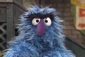 Who is this blue, fuzzy monster with the thick eyebrows?