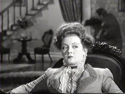 NAME THAT FILM: Bette plays a woman who allows her husband to die so she might inherit his wealth.