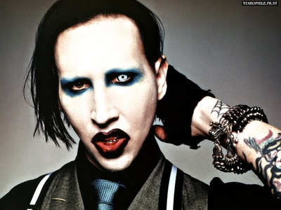Which CSI star can be seen wearing a denim miniskirt in a Marilyn Manson video?