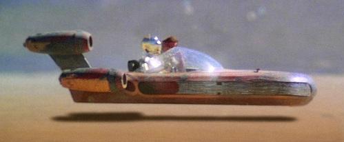 What landspeeder model does Luke blame for dropping the resale value on his old X-34 landspeeder?