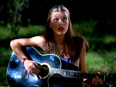 TRUE or FALSE:  The song Michelle sings in this scene is actually a song from one of Milla Jovovich's albums.