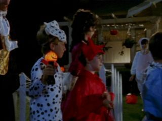"What does Mrs Davies give the trick ou treat kids in episode ""Halloween""?"