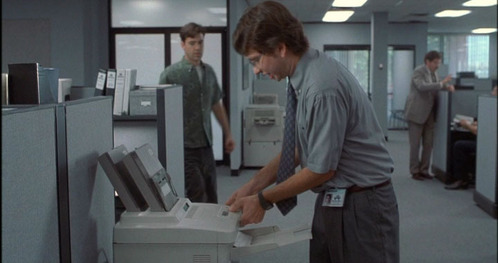 What does the printer keep telling Michael that makes him so angry?