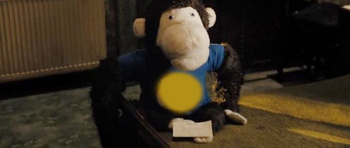 What is written on the toy monkey that Nicholas wins at the fair?