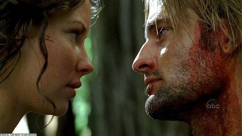 In what episode did Sawyer and Kate of lost first kiss?