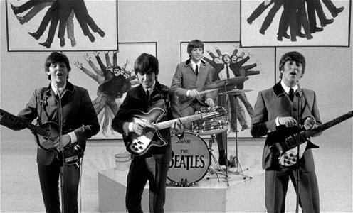 "Which of the Beatles wins the card game in the scene of A Hard Day's Night when they are singing ""I Should Have Known Better""?"