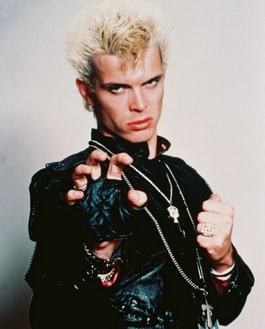 What punk band did Billy Idol front before becoming a solo artist?
