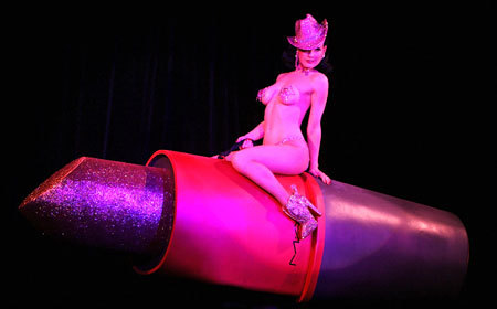 Which of the following objects have been incorporated into Dita's burlesque routines?