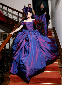 Which designer created the purple, silk taffeta wedding gown Dita wore for her 2005 nuptials with rocker Marilyn Manson?