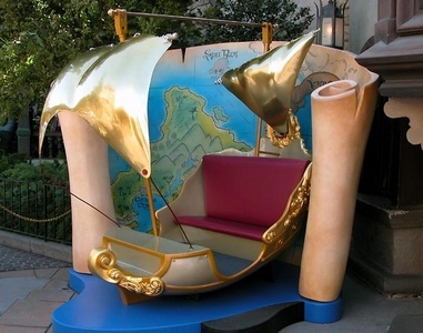 Disneyland 101: Which Disney ride features golden ships of the sort pictured below?