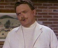 FOR THE DIE-HARD FAN: Actor Bernard Fox (Dr Bombay) starred in the original & remake versions of which movie?