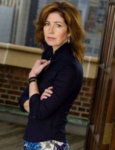 Which ex-Firefly star now has a regular role on a popular ABC Comic Drama across Dana Delany (the actress depicted below)?