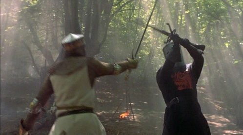 What is the first body part of the Black Knight's that Arthur chops off?
