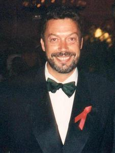 In the cult film, Rocky Horror Picture Show, what two roles does Tim Curry play?