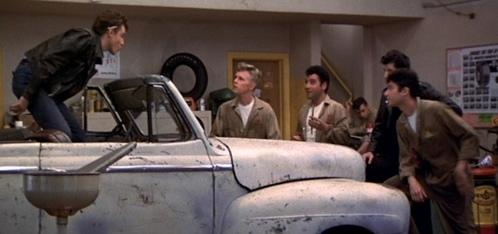 Which of these things is Kenicke's car NOT according to Danny Zuko?