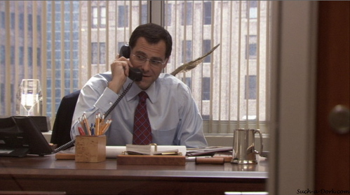 When he's not playing David Wallace on The Office, what does Andy Buckley do for a living?