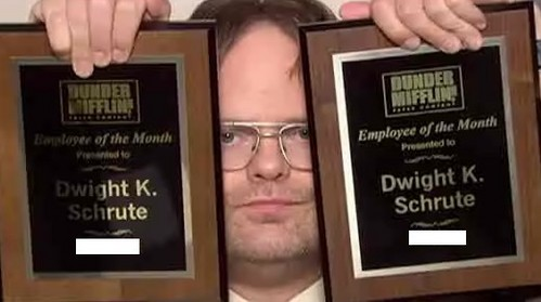 "In which month did Dwight receive the honor of ""Salesman of the Month"" twice?"