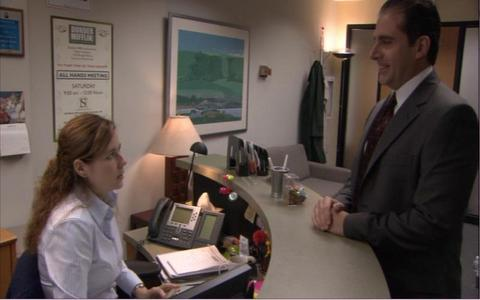 "At the beginning of ""Health Care"" what does Michael ask Pam to do (for the benefit of the camera) that she has already done?"