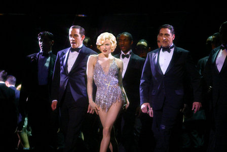 "Which song is not featured in ""Chicago"" on Broadway but was added to the 2003 movie version?"