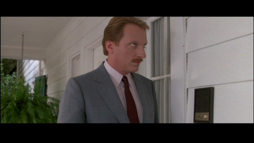 In Ferris Bueller's día Off, what reason does Ferris give as why he can't come to the door when Principal Rooney rings his doorbell?