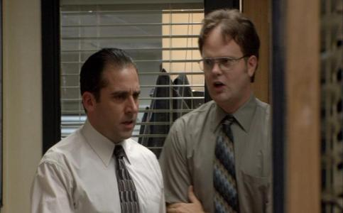 "At the beginning of ""The Alliance"" where is Dwight waiting for Michael"