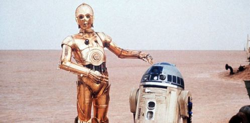 After landing on Tatooine, what does C-3PO call R2-D2 during an argument?