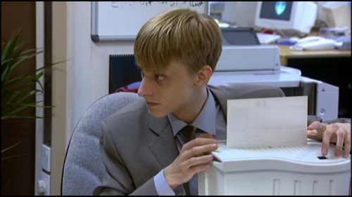 What shape was the cookie jar that Gareth brought to the office?