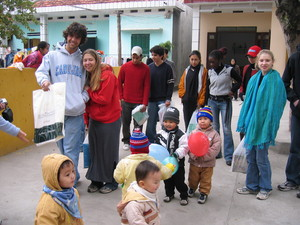 Cinders (in the red sweatshirt) volunteering at a preschool in Vietnam with classmates